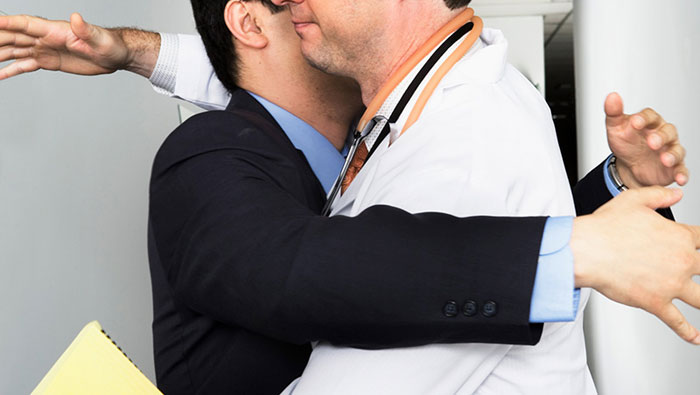 Doctor gets a hug so tight it cracks his ribs