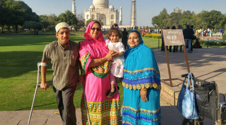 Dr. Jetpurwala (in pink) with son, daughter-in law and granddaughter