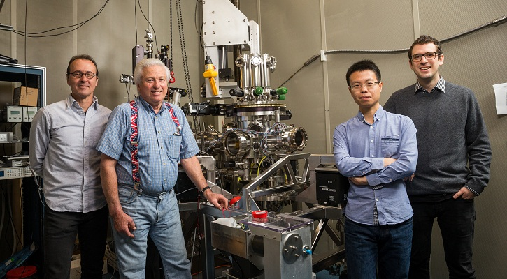 IBM scientists, with their award-winning microscope used to encode the atomic hard drive - IBM Research