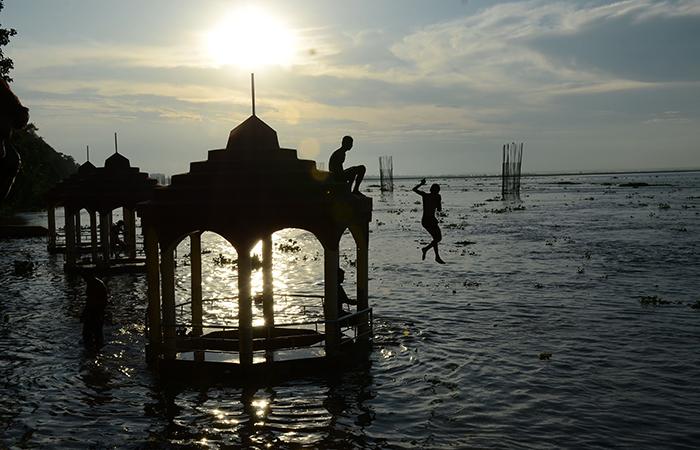 Kid Jumping in Ganga