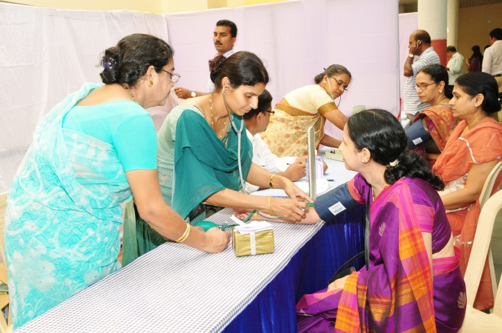 Government plans lower I-T slab, free health check-ups for women