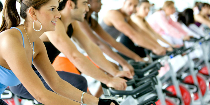 . The additional motivation, which is a huge component if your use the stationary bike in a spin class, such as the pounding music, group atmosphere and motivation from the instructor can help keep urging you on