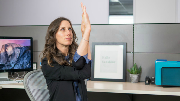 Christina Robohm a yoga instructor from Oakland California has created a mini-yoga series that help alleviate stiffness in your neck, arms, shoulders, back and your wrist in a 6-minute routine that can be performed right at your workstation