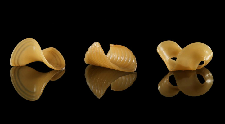 These pasta shapes were caused by immersing a 2-D flat film into water - Michael Indresano Production/MIT