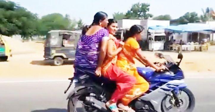 Saree-clad women riding a sports bike