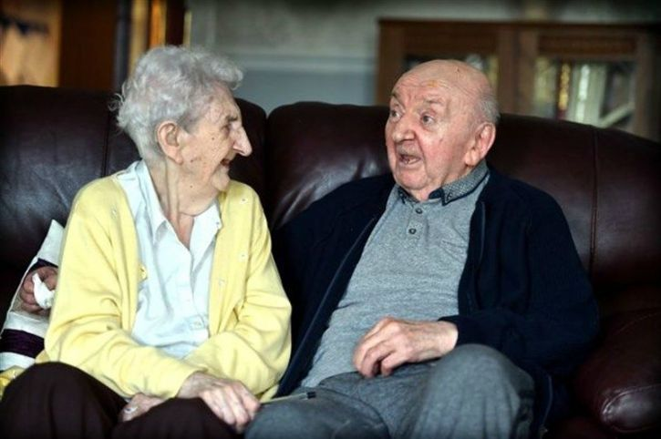 """There are very few things that are more special than a bond between a mother and her child. The story of Ada Keating, 98, who joined her oldest son Tom, 80 in an care home in Liverpool to look after him, is one such example.  They share a special relationship as Tom, who has never married, has always lived with Ada. They are literally inseparable and love spending time with each other; especially playing games together and watching Emmerdale.   """"I say goodnight to Tom in his room every night and I'll go and say good morning to him,"""" says Keating, a former auxiliary nurse, said.   """"I"""
