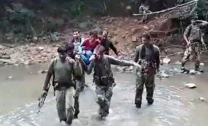 CRPF Men Carry Sick tribal Woman