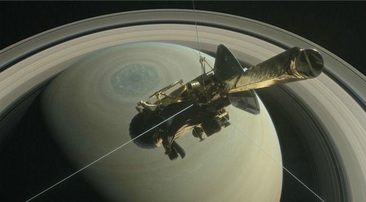 A representational image of Cassini diving through Saturn