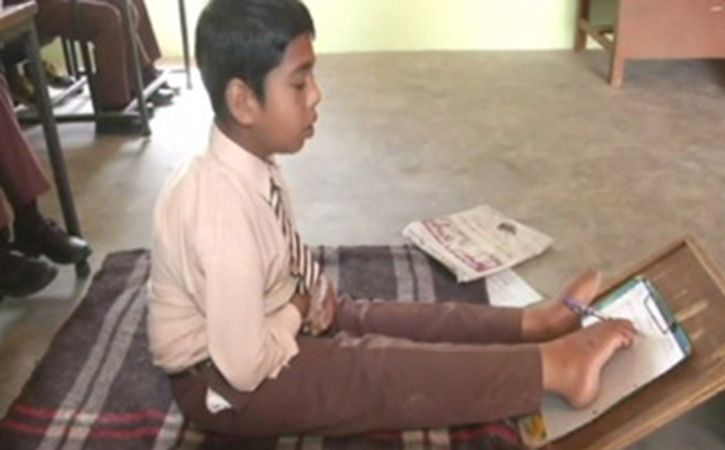 11 Year old Kamaljeet Singh writes exam with toes