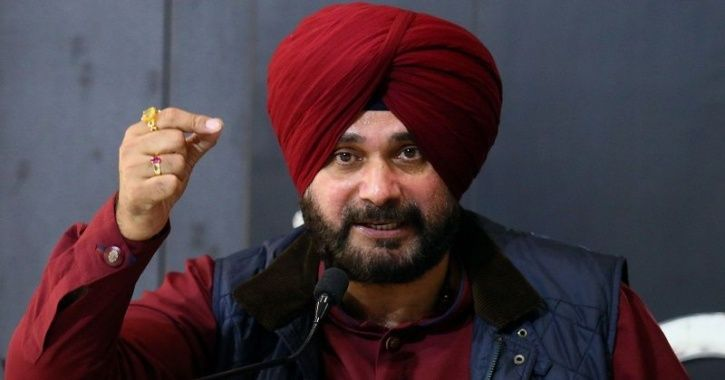 A picture of Navjot singh Sidhu speaking at a conference.