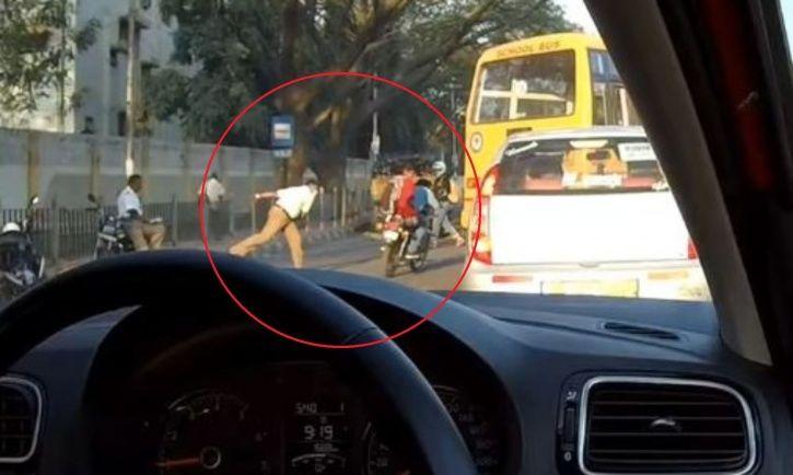 Bengaluru cop throws his chappal at helmet-less drivers