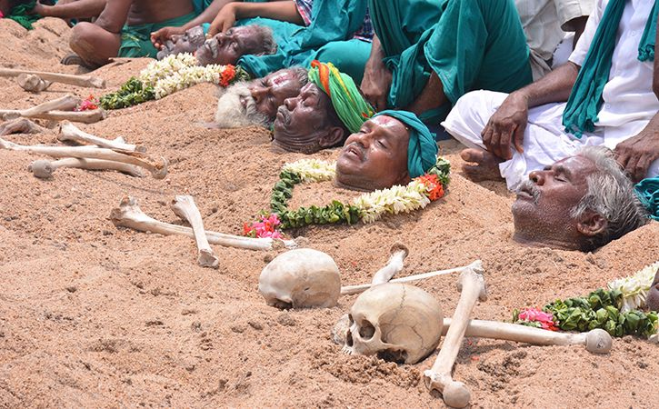 Farmers Bury Themselves In Sand