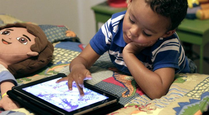 kid playing with android app
