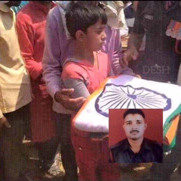 Martyr Nilesh Kumar son holding tricolour