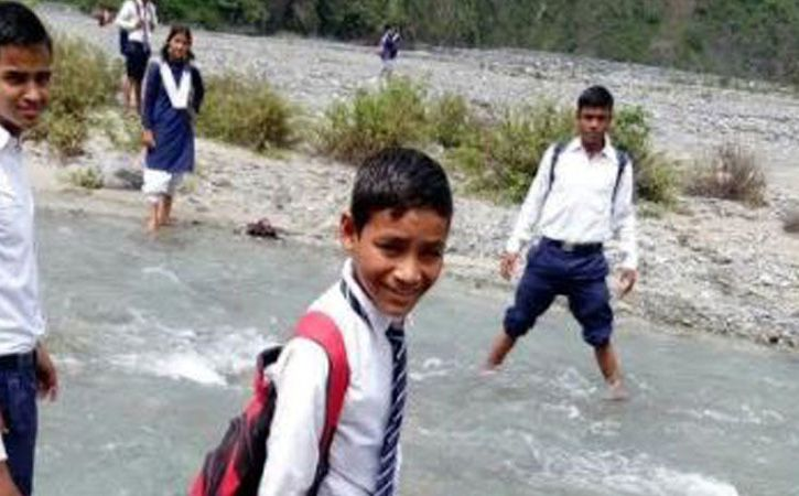 Swimming across Gaula river to reach her school
