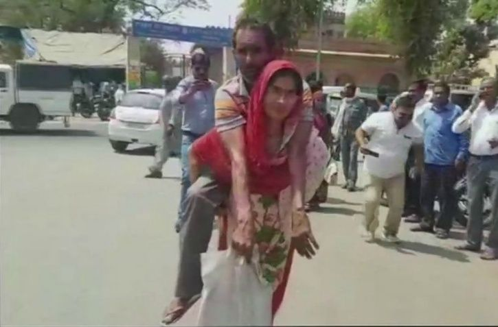 Woman Carries Husband On Her Back