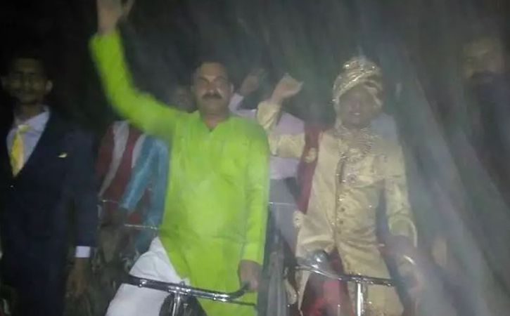 youth decided to ride a bicycle along with the baratis to his bride home