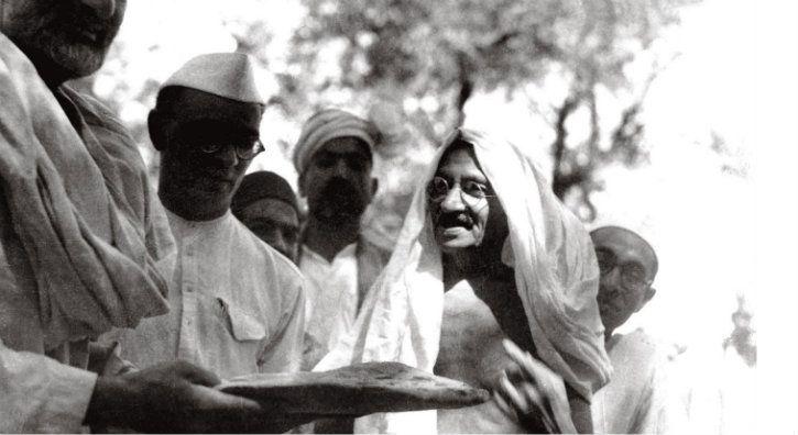 Gandhi and Mahadev Desai with Khan Abdul Ghaffar Khan at Utmanzai in 1938