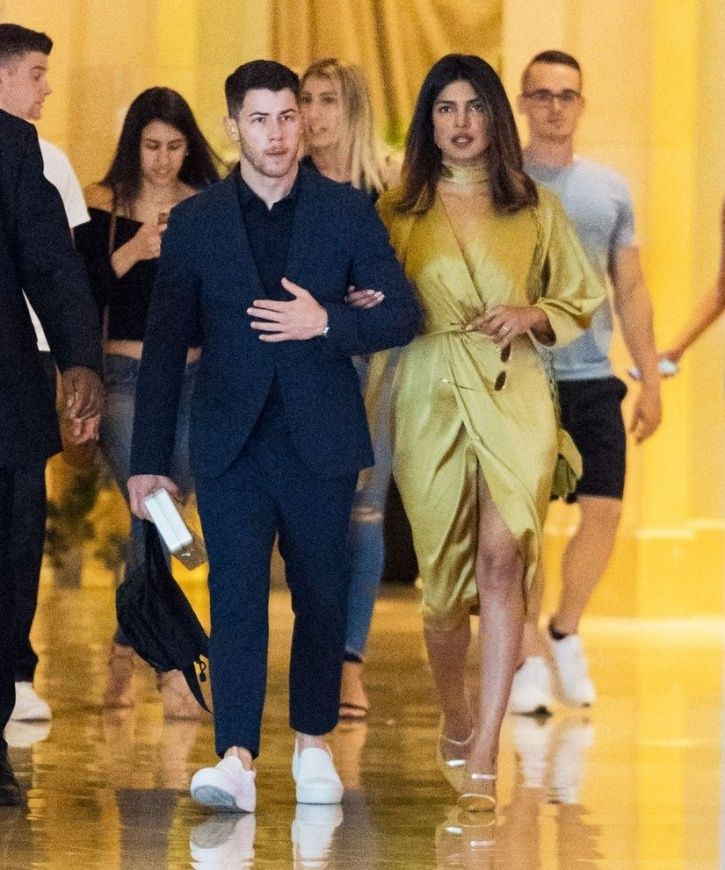 Priyanka Chopra and Nick Jonas holding hands.
