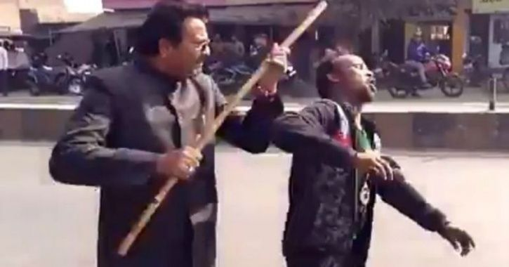 BJP Leader Shoves Stick Inside Disabled Man's Mouth For Saying That He