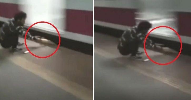 Man Gets Stuck Between Running Train and Platform
