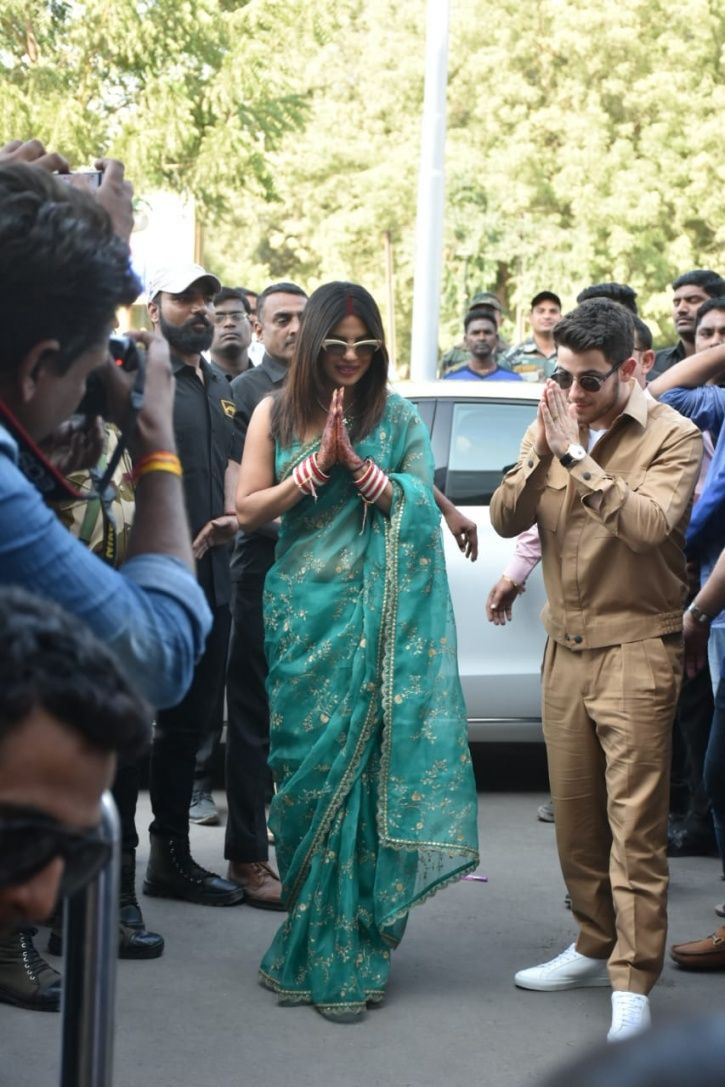 Priyanka Chopra & Nick Jonas Make Their First Appearance As Married Couple, Greet Fans With Namaste