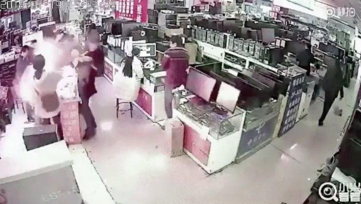 chinese man bites into battery which explodes