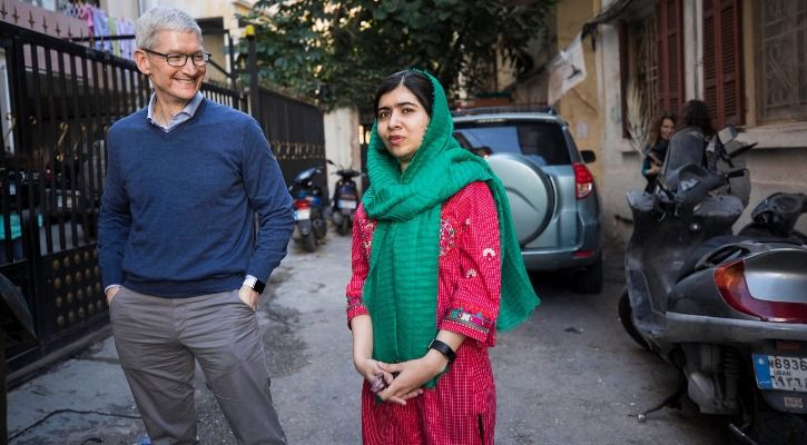 Malala Yousafzai and Tim Cook outside the home of a family with daughters attending school in Beirut