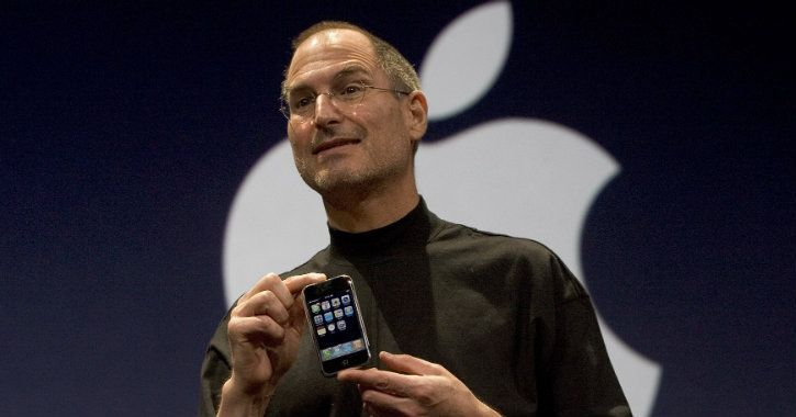 Steve Jobs with the original Apple iPhone