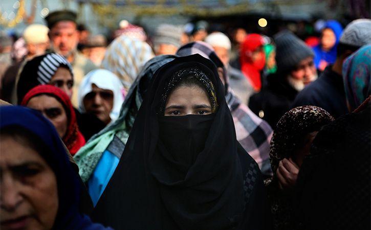 threatening Kashmiri women if they did not observe the Islamic dress code