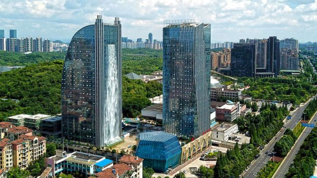 A Chinese skyscraper has an artificial waterfall that stands at a whopping 350 feet. The water casca