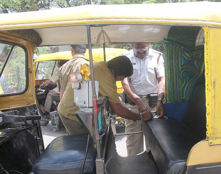 Auto Driver Fined For Not Wearing Helmet
