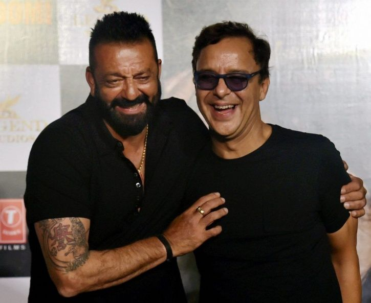 A picture of Vidhu Vinod Chopra  and Sanjay Dutt at the launch of Sanju.
