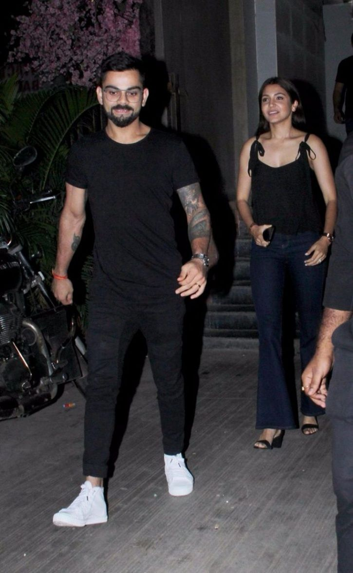 A picture of Virat Kohli and Anushka Sharma colour-coordinating for a romantic dinner date.