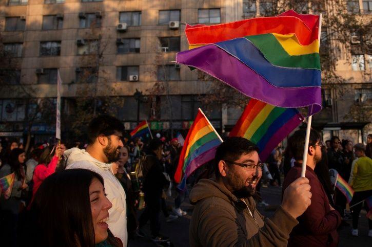 flag hoisting, rainbow flag, pride parade, June