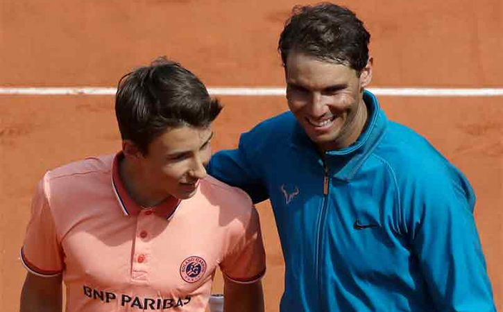 Rafael Nadal Rallies With A Ball Boy After Entering Pre Quarters