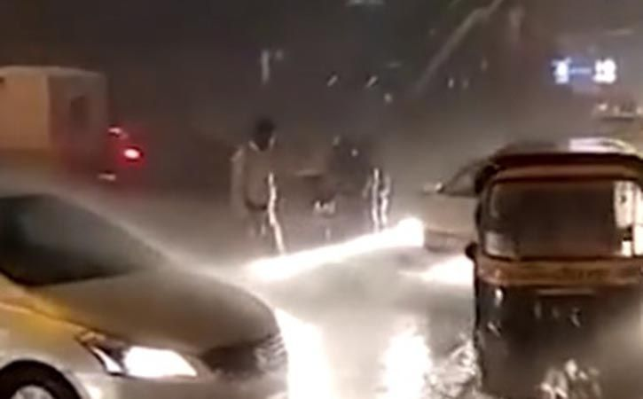 This Mumbai Traffic Cop Stood In Rain For Two Hours
