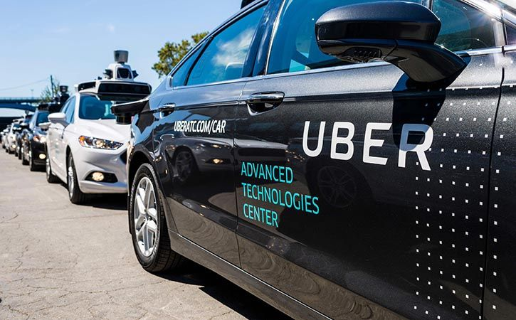 An Uber self-driving car hit and killed a woman crossing the street in Arizona, police said on Monda