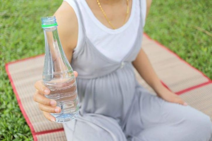 drink water from plastic bottles