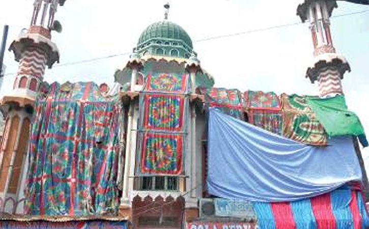 For Protection From Colours Aligarh Mosque Covered Ahead Of Holi