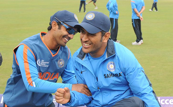 I am studying in the university in which Dhoni is topper