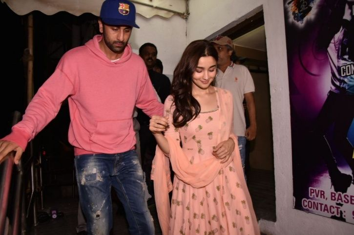 A picture of A picture of Alia Bhatt and Ranbir Kapoor at Raazi screening.