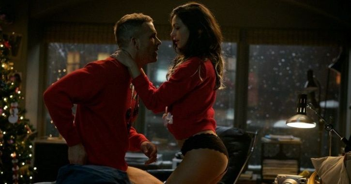 A picture of Morena Baccarin kissing Ryan Reynolds in Deadpool.