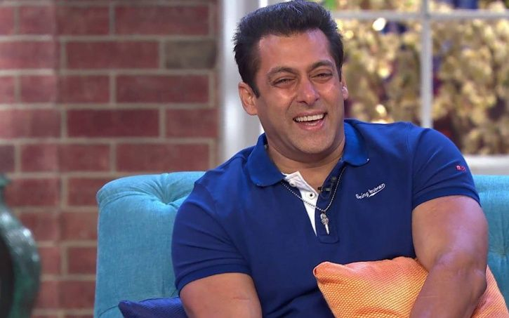 A picture of Salman Khan laughing uncontrolably.