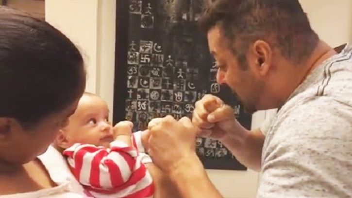A picture of Salman Khan playing with his nephew Aahil.