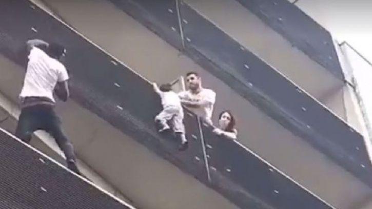 man saves hanging child