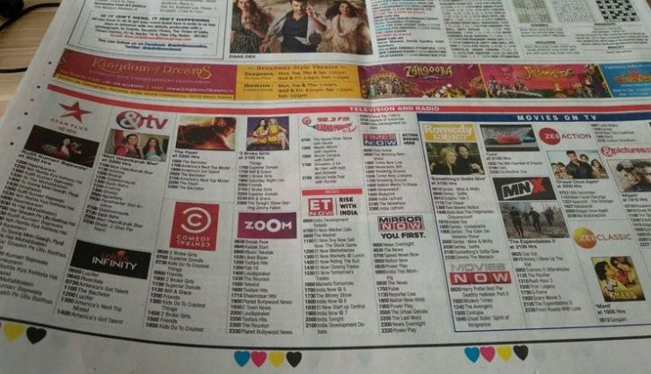 reading news paper for tv schedule