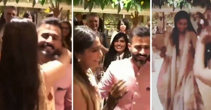 Sonam Kapoor and Anand Ahuja hug and dance together at their wedding ceremony.