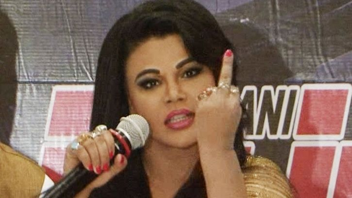 A picture of Rakhi Sawant showing her middle finger.