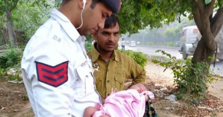 Delhi Traffic Cops Save Life Of A Female Infant Found Abandoned & Surrounded By Dogs